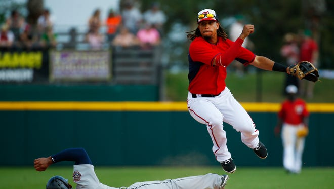 Tigers third baseman Jefry Marte can't stop the Nationals' Emmanuel Burriss from turning the double play.