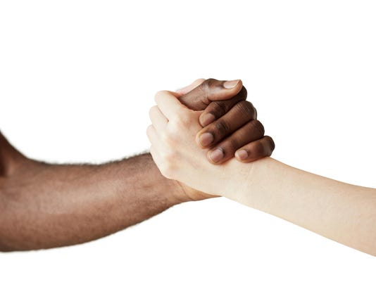Multiracial handshake between black African man and white