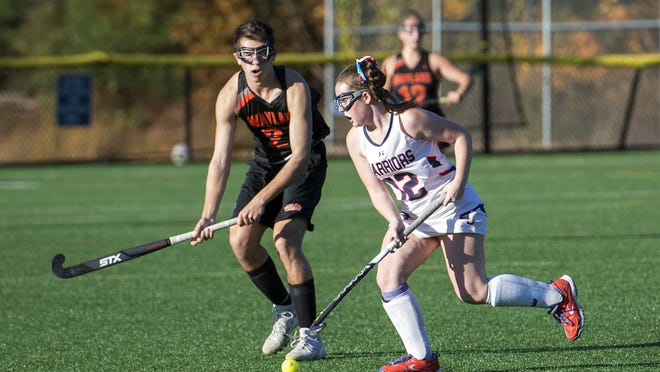 Lincoln-Sudbury's Sarah Molloy controls the ball, under pressure from former Wayland player Aiden Chitkara, during a game in Sudbury on Oct. 23, 2019. Molloy scored three goals in the Warriors' win over Westford on Monday.