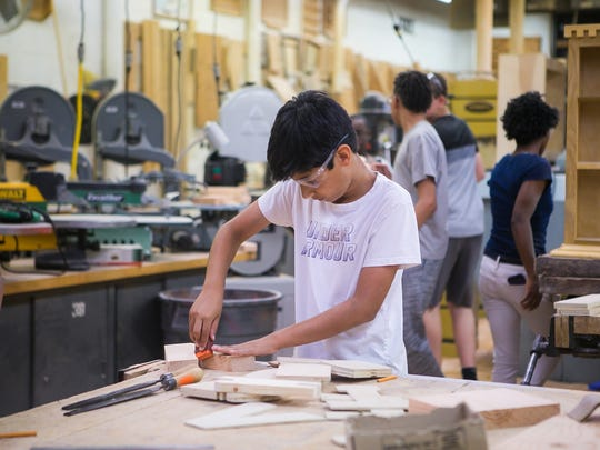 Vishnu Gadicharla, 13, works in the carpentry class as New Castle County middle schoolers in 6th and 7th grades learn technical skills at the Build Your Future! Construction Technologies Camp held at Delcastle Technical High.