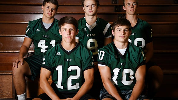 East Henderson football players, front row, from left,