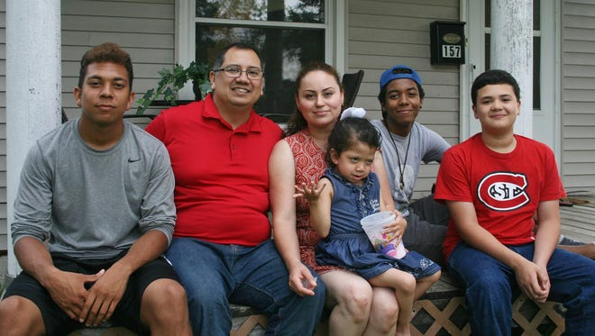 Members of the Hernandez-Madrid family deal with misunderstandings about language and relationships even though they are among growing numbers of blended, biracial families in the U.S. Shown from left to right are Kendrick Hernandez, 16; David Hernandez; Luz Madrid; Allison Hernandez-Madrid, 5; Brandon Hernandez, 15; and Andrew Buscamante-Madrid, 12.