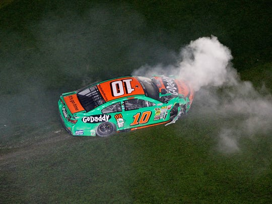 DAYTONA BEACH, FL - FEBRUARY 23:  Danica Patrick, driver of the #10 GoDaddy Chevrolet, sits in the grass after an incident during the NASCAR Sprint Cup Series Daytona 500 at Daytona International Speedway on February 23, 2014 in Daytona Beach, Florida.  (Photo by Brian Lawdermilk/Getty Images)