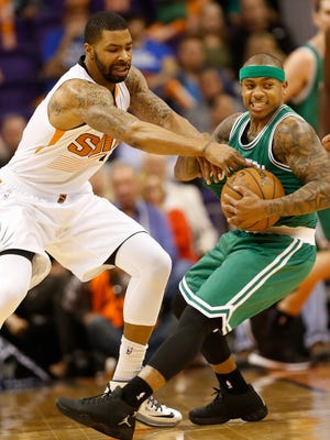 Phoenix Suns forward Marcus Morris tries to steal the ball from Boston Celtics guard Isaiah Thomas during the first quarter at US Airways Center in Phoenix, Ariz. February 23, 2015.