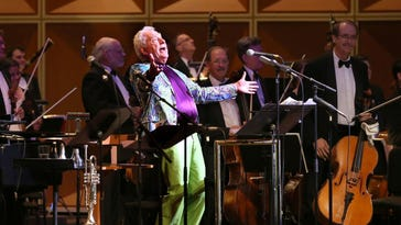 Doc Severinsen milks the audience for more applause during Friday's Milwaukee Symphony Orchestra concert at the Marcus Center.