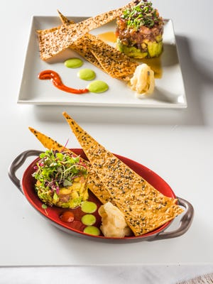 Zea Rotisserie and Grill recently introduced new small and sharable plates, such as this tuna sashimi stack topped with diced yellowfin tuna, avocado, cucumber and wasabi aiolo.