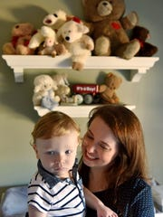 Chelsea Lamb holds her 14-month-old son Jay at home in Brandon Tuesday. Jay was born with a genetic condition that causes benign tumors called tuberous sclerosis. Chelsea and her husband, James, both work full-time jobs and both have health insurance yet they believe they would not be able to afford their son's medical expenses without the aid of Medicaid.