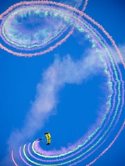 "The U.S. Navy Parachute Team ""The Leap Frogs"" perform Saturday, Nov. 11, 2017, during the Blue Angels Homecoming Air Show at Pensacola Naval Air Station."