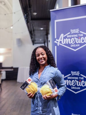 Isis Arrieta-Dennis, owner of The Arepa Place, after winning a grant from Brewing the Great American Dream