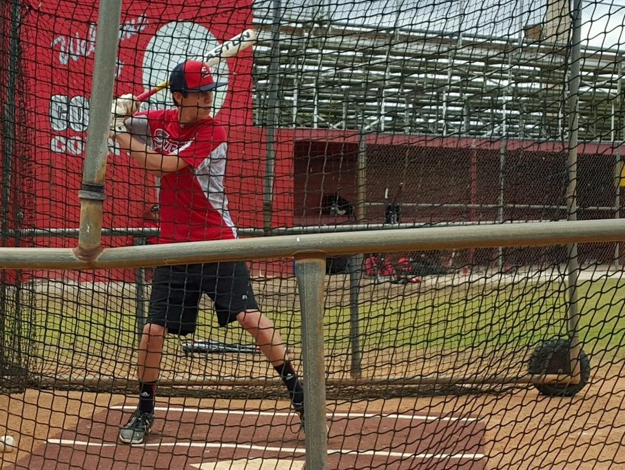 LaBelle sophomore Efrain Torres prepares for game action by hitting in the batting cage.