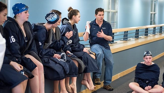 Asheville School coach Frank Kriegler and the Blues won Friday's Carolinas Athletic Association boys and girls swimming championships.