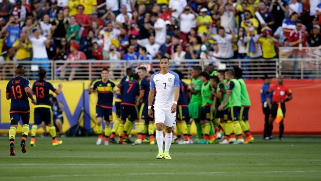 Colombia's players celebrate after scoring their first goal as United States' Bobby Wood, center, walks away during a Copa America Centenario Group A soccer match at the Levi's Stadium in Santa Clara, Calif., Friday, June 3, 2016. Colombia scored 2 first-half goals beating the US in the opener of the Copa America.