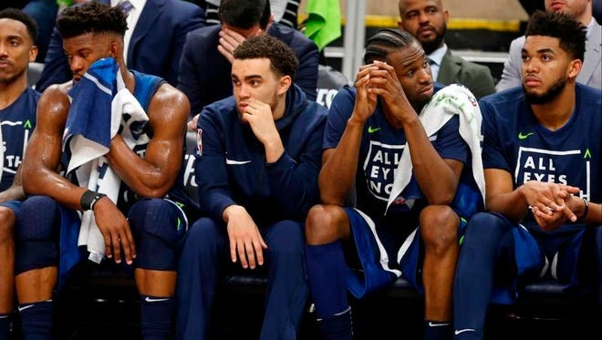 Minnesota Timberwolves players, from left, Jimmy Butler, Tyus Jones, Andrew Wiggins and Karl-Anthony Towns sit it out in final couple minutes during the second half of Game 4 in an NBA basketball first-round playoff series Monday, April 23, 2018, in Minneapolis. The Rockets won 119-100, and lead the series 3-1.