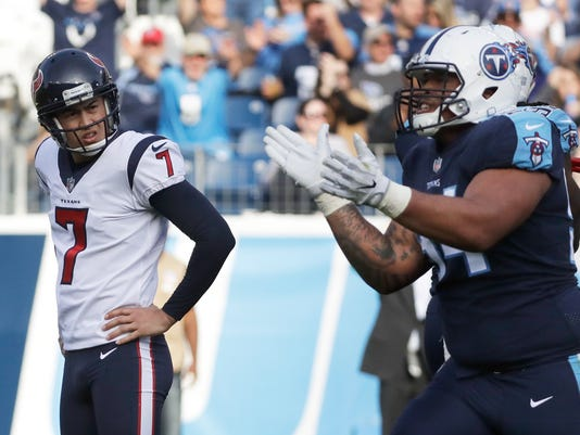Houston Texans kicker Ka'imi Fairbairn (7) looks over at Tennessee Titans nose tackle Austin Johnson (94) after Fairbairn missed a 28-yard field goal attempt in the second half of an NFL football game Sunday, Dec. 3, 2017, in Nashville, Tenn. (AP Photo/James Kenney)