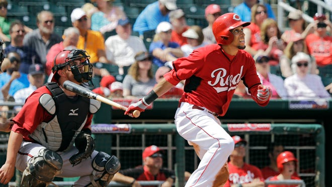 Center fielder Billy Hamilton watches the flight of his triple in the fourth inning against the Diamondbacks Thursday. He previously hit another.