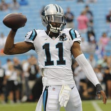 Tiquan Underwood (11) warms up before the game against the Buffalo Bills at Bank of America Stadium.