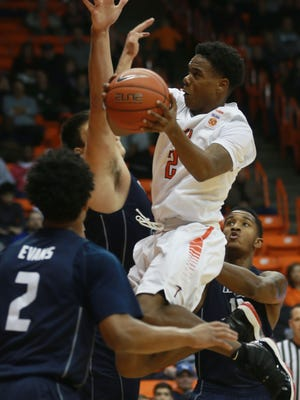 UTEP's Omega Harris drives to the basket against Rice defenders during the first half Friday. The Miners went on to win the game 61-60.