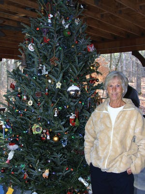 Janie Wells stands beside the Memory Tree at Joann's Classroom in Bowie Nature Park.