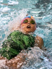 Drea Echard, swimming for the Valley View Gators, swims the backstroke in the medley relay at the Tri-County Aquatic League Championship swim meet at Denison University.
