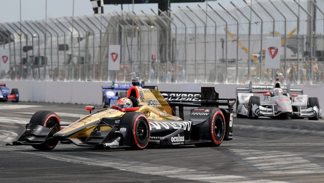 James Hinchcliffe (5), of Canada, leads Will Power (12), of Australia, early in the IndyCar Firestone Grand Prix of St. Petersburg auto race Sunday, March 12, 2017, in St. Petersburg, Fla.