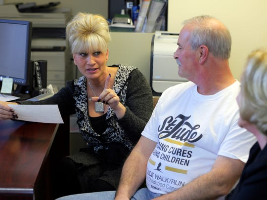 (center) Asbury Park resident Rick Binaco, who recently found his lost gift certificate from co-workers in 2003 for $1,200 to travel anywhere while he was being treated for advanced cancer, talks about the experience with (left) Maria Iadonisi, who collected the money from co-workers and bought the gift certificate for Binaco.