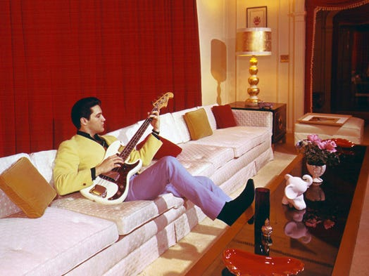 Elvis fiddles with an electric bass inside Graceland in this photograph published March 7, 1965, in the first issue of Mid-South, the now-defunct Sunday magazine of The Commercial Appeal. Elvis had misgivings about allowing pictures to be made inside his home. 'It's not that I don't want pictures,' he said. 'You know what I mean. Some people might think I am looking for publicity or trying to exploit my home. I certainly don't want anyone to think that.'