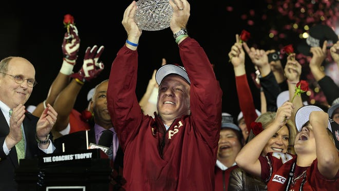 Florida State head coach Jimbo Fisher celebrates the Seminoles' national-championship win over Auburn on Jan. 6, 2014.