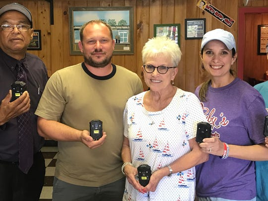 "Several Opelousas business owners have come together to help the Marshals Office by purchasing body cameras for tdhe deputy marshals. With the current affairs that law enforcement is forced to deal with on daily basis, we must have a clear path to accountability. ""It is a known fact that people behave differently when they know they are being watched, use of force incidents and complaints can easily be resolved by pressing play"", Mouton said. Budget cuts hinder our ability to be efficient but with their amazing support, we can continue to progress in the right direction, the new cameras will replace outdated equipment. Pictured: Marshal Paul Mouton, Derrick Comeaux, Elaine Cormier, Laurie McDaniel, Alexis DeVillier, Robbie DeVillier (not pictured)"