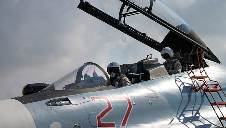 Russian pilots in the cockpit of a fighter bomber at