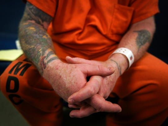 Shane Tucker is a work aide while he is locked up in Louisville's Metro Corrections.