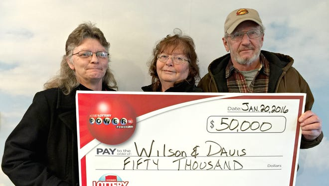 Carla Davis (from left), Cindy Wilson and Fred Wilson claimed their prize on Jan. 20 in Indianapolis.