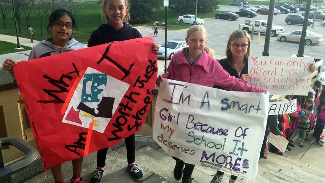 About 100 students from Des Moines and southeast Warren school districts rallied at the Iowa Capitol Wednesday for increased school funding. These students, all from Perkins Elementary School in Des Moines, are, left to right, Ashley Nino, 10, Isabel Davis, 10; Ashley Dobson, 10, and Cecilia Hatfield, 11.