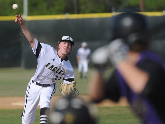 Abilene High pitcher Ryan Johnson throws a pitch to a Keller Timber Creek batter in the fourth inning. Johnson went the distance in the Eagles' 4-1 victory Tuesday, April 24, 2018 at Blackburn Field.