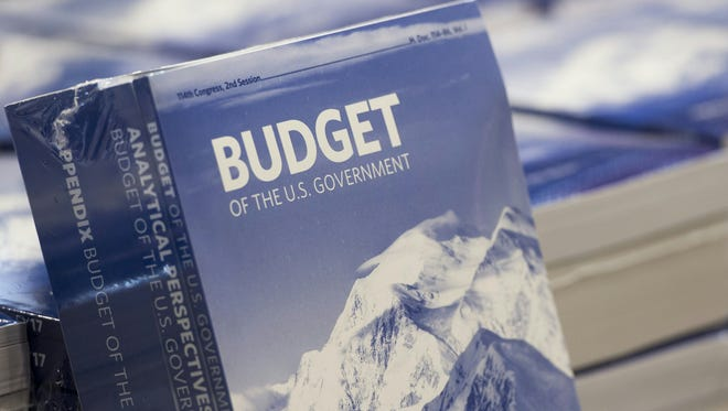 Copies of President Obama's Fiscal Year 2017 budget are distributed on Capitol Hill Tuesday.