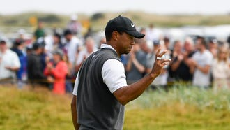 Tiger Woods waves to the crowd after he birdies on the fourth hole during the third round of The Open Championship.