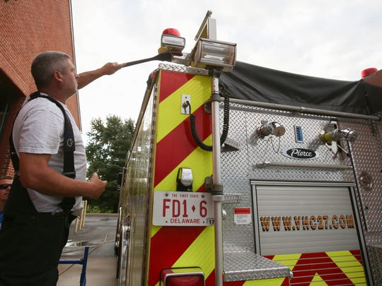 Mike Misetic of Middletown helps scrub a fire truck as at Middletown's Volunteer Hose Co. Fire Station 1 Tuesday.
