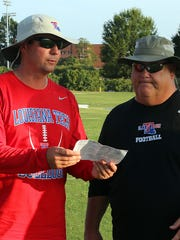 Louisiana Tech quarterbacks coach Tim Rattay, left,