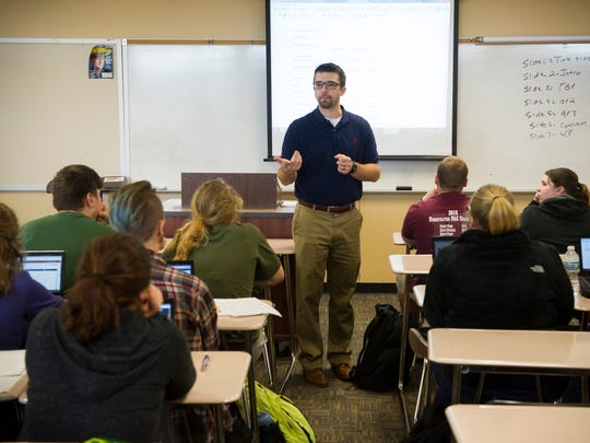 Kyle Brasher of Haubstadt, speaks to students in his American literature class at Gibson Southern High School.