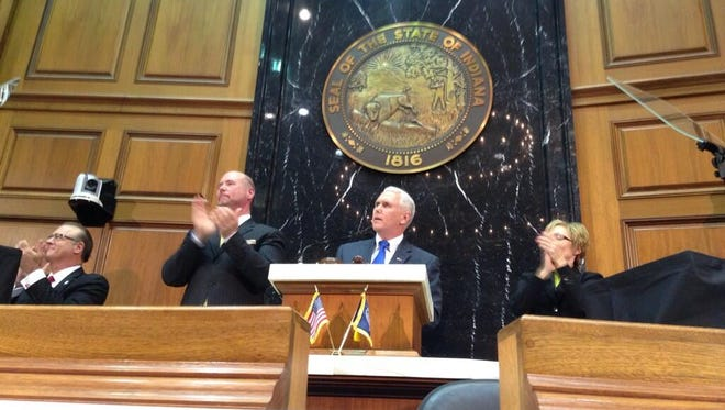 Gov. Mike Pence (center) delivered his State of the State speech at the Indiana Statehouse Tuesday, Jan. 14, 2014.