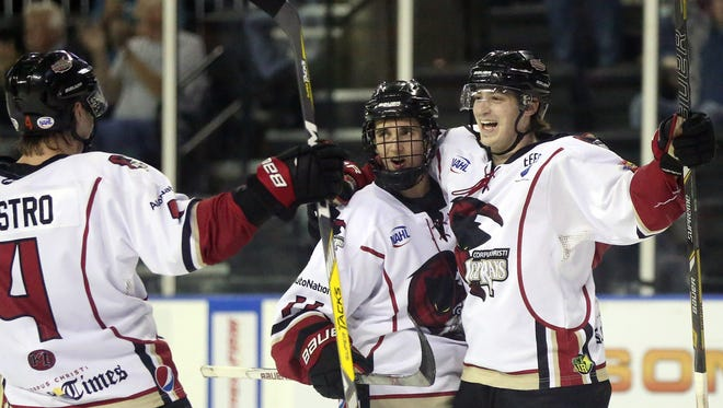 IceRays' Brendan Miller (right) celebrates with teammate David Baskerville (center) and Logan Gestro after scoring a goal against Topeka during the third period on Friday, Feb. 17, 2017, at the American Bank Center in Corpus Christi
