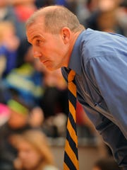 Caesar Rodney head coach Dickie Howell watches action during a match with Smyrna.