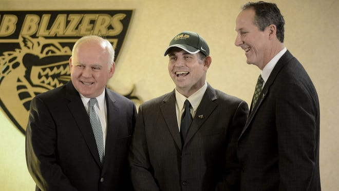 File photo shows UAB football coach Bill Clark  center, with UAB President Dr. Ray Watts, left, and Brian Mackin, director of athletics, at Bartow Arena in Birmingham.