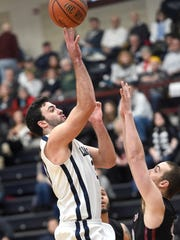 Lebanon Valley sophomore Will Boccanfuso  throws up a floater against Arcadia during Saturday's 93-75 Dutchmen home win.