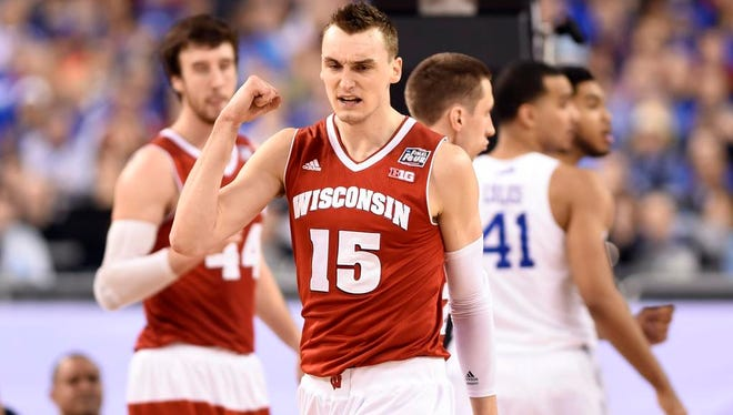 Wisconsin Badgers forward Sam Dekker (15) reacts after a basket against the Kentucky Wildcats in the second half of Saturday's NCAA tournament semifinal game at Lucas Oil Stadium in Indianapolis.