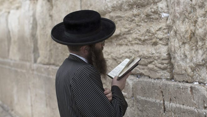 An Ultra-orthodox Jew prays at the Western Wall in the Old City of Jerusalem on Nov. 11.