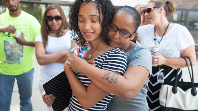 13-year-old Amber Andujar is hugged by her aunt Naomi Burgos of Camden outside of the Camden County courthouse after a jury found Osvaldo Rivera guilty on Friday of all charges he faced, including murder and sexual assault.   Rivera is charged in the 2012 killing of 6-year-old Dominick Andujar as the boy rushed to aid his sister, Amber Andujar, as Rivera was sexually assaulting her after invading their Camden home.  Rivera slashed the throats of both children. Dominick was killed and Amber survived.   06.11.14