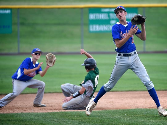 Campbelltown's Isaac Blatt catches a throw but not in time to stop Fredericksburg's Bailey Keefer from stealing second base.