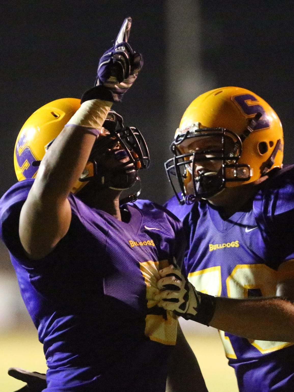 Smyrna players celebrate as the Bulldogs defeated Stewarts