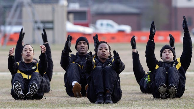U.S Army troops in training to become instructors participate in the new Army combat fitness test at the 108th Air Defense Artillery Brigade compound at Fort Bragg, N.C.