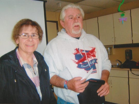 James Campbell from the Never Forgotten Honor Flight was the guest speaker at the June meeting of the Royal Neighbors of America Camp No. 561. He showed slides and presented the history of the honor flight. As pictured, Sharon Jacobson, event planner, at left, presented Jim, at right, with a $200 check for the honor flight project.